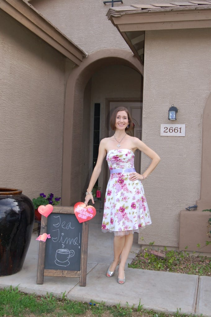 Me in my party dress with my chalkboard sign. My Signature Event, the potluck tea party! on Tabithadumas.com