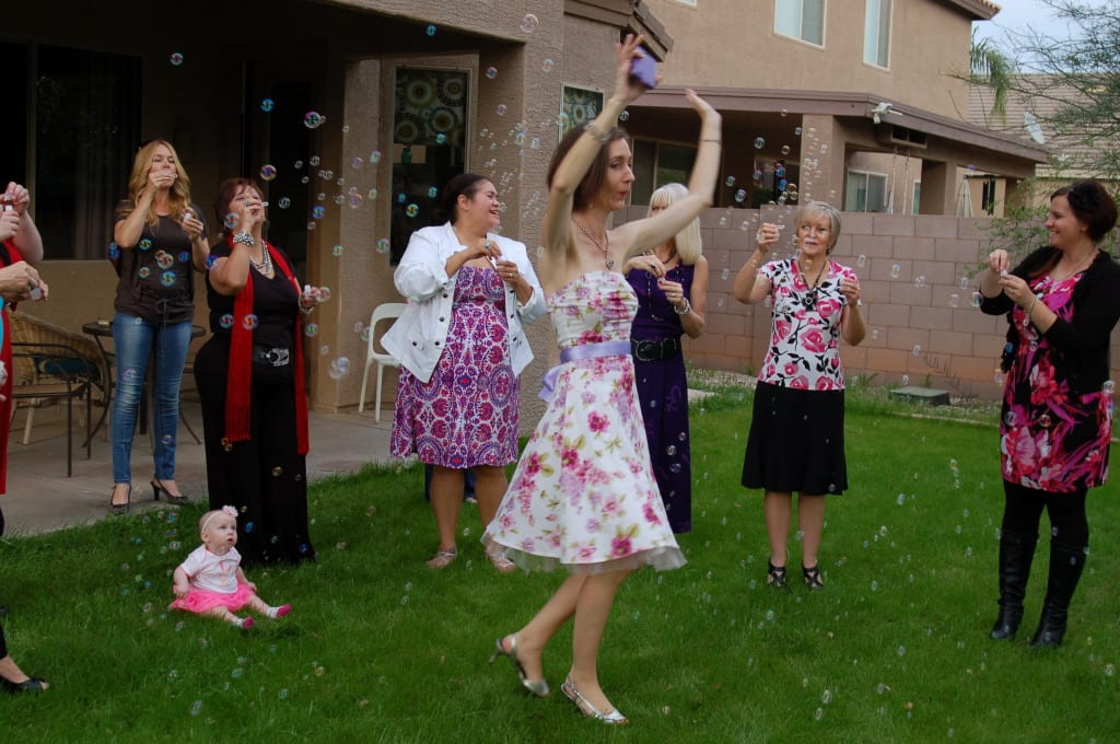 My Signature Event, the potluck tea party! on Tabithadumas.com. Running through bubbles is a blast!