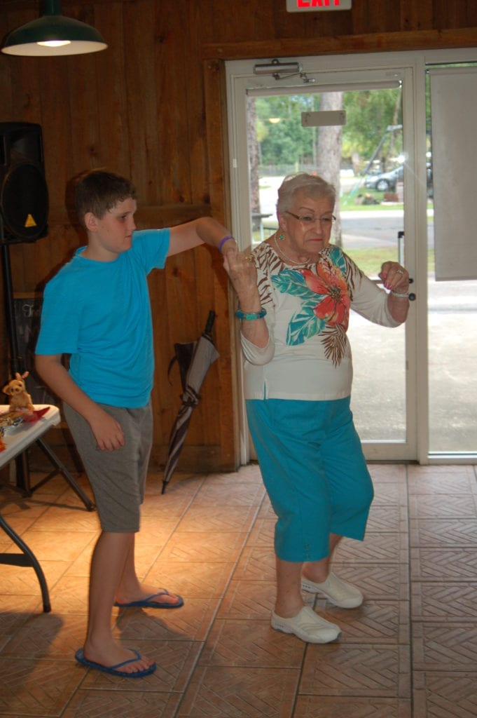 Andrew dancing with his grandmother on her 90th birthday
